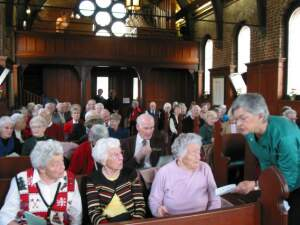Photo of capacity audience for 2003 Christmas concert,           Pemberton Chapel, Royal Jubilee Hospital